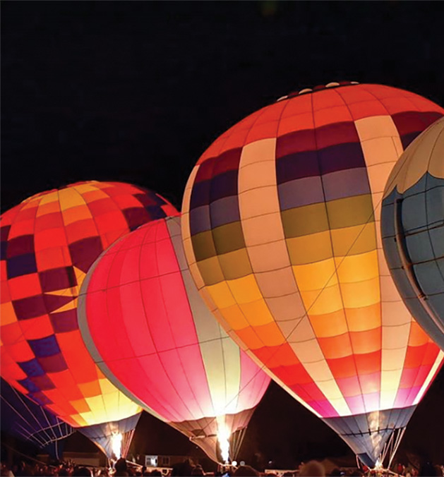 A night sky filled with hot air balloons at the Hudson Hot Air Affair 2020