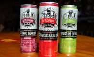 Three cans of Lift Bridge Brewing Co.'s hard seltzers - St. Croix Berries, Northwoods Juicebox and Voyageurs Citrus
