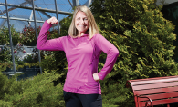 Kelly Fox, director of healthy living at the Hudson YMCA, flexes her muscles.