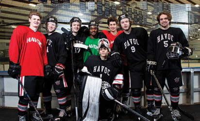 Players from the Hudson Havoc junior hockey team pose for a photo.
