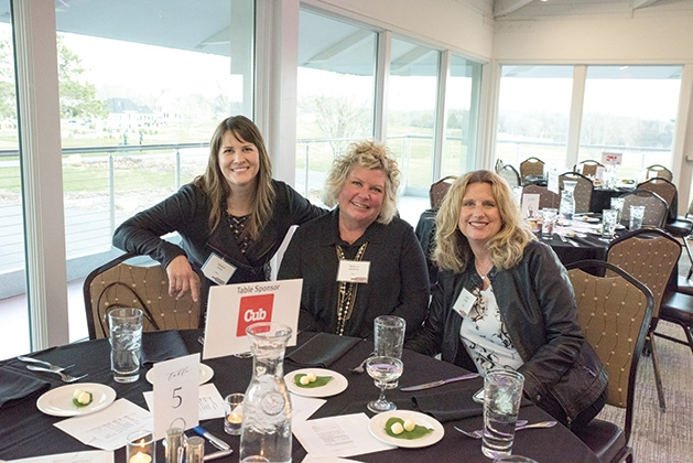 Three guests sit at a table at United by the Vine 2019
