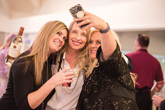Three women take a selfie at United by the Vine 2019