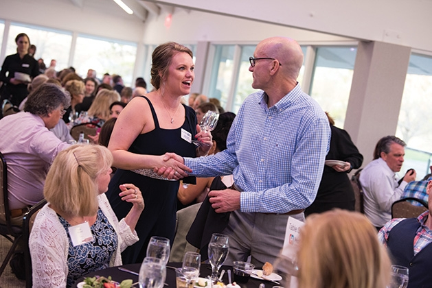 Two guests shake hands at United by the Vine 2019