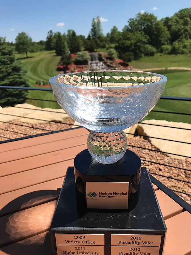 The Challenge Cup is awarded to the team at the Hudson Hospital Golf Tournamentthat has the best score in an industry. Picadilly Valet won the retail industry trophy