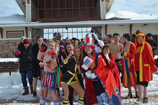 People in costumes pose for a photo at the St. Croix River Dunk