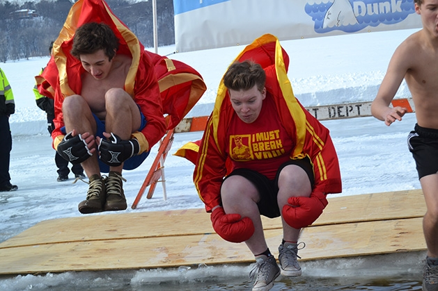Two boys jump into the water at the St. Croix River Dunk