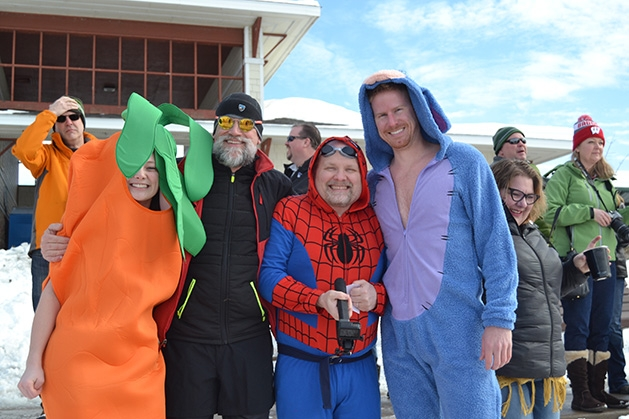 Costumed characters - including a carrot, Spider-Man and a shark - pose at the St. Croix River Dunk