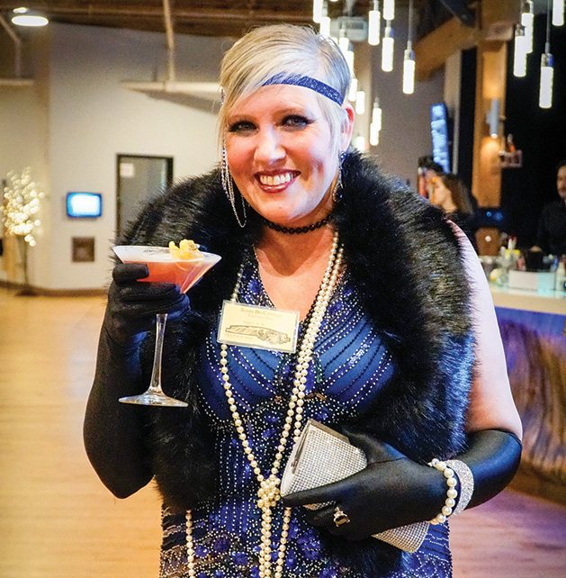 A Stillwater Chamber Gala attendee poses with a drink.