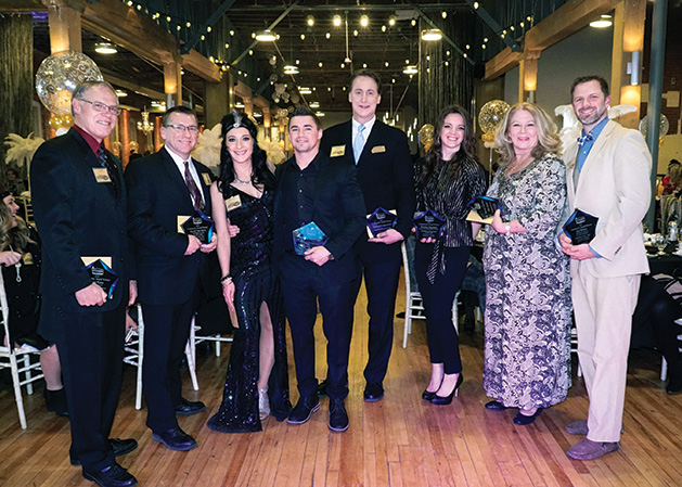 Attendees at the Stillwater Chamber Gala pose for a photo.