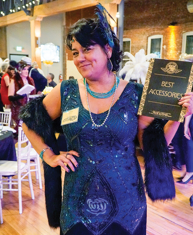 An attendee at the Stillwater Chamber Gala poses for a photo.