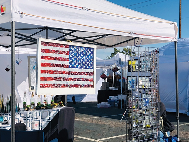 A booth at the Rivertown Fall Art Festival 2019