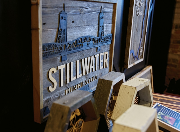 A wood-carved Stillwater Bridge sign from Smith + Trade Mercantile