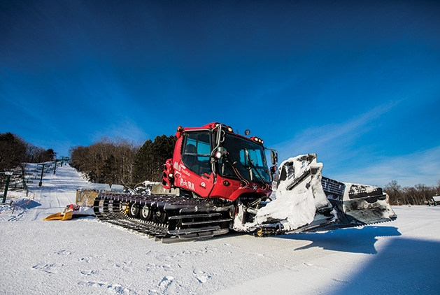 A grooming machine on the slopes at Wild Mountain