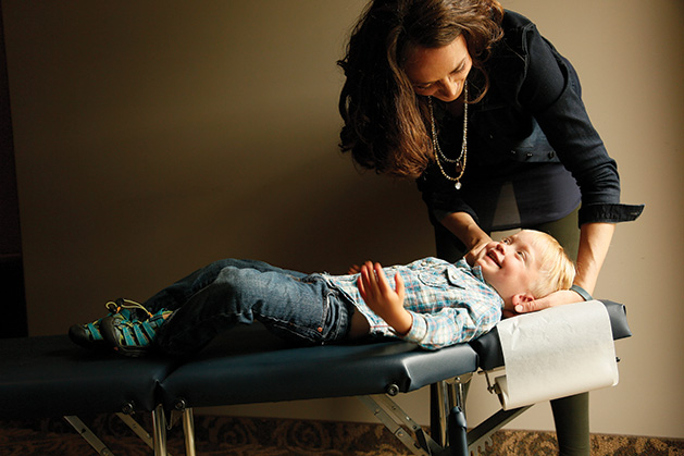 A chiropractor from Croixview Family Chiropractic works on a patient.