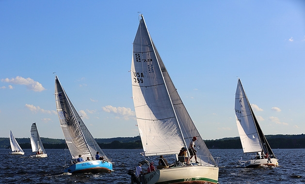 Five boats sail on the St. Croix River during a race.