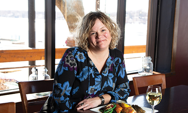 Pier 500 assistant general manager Katy Rugg enjoys a meal and a glass of white wine.