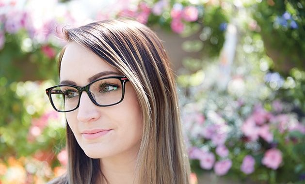 A woman models a pair of statement glasses.