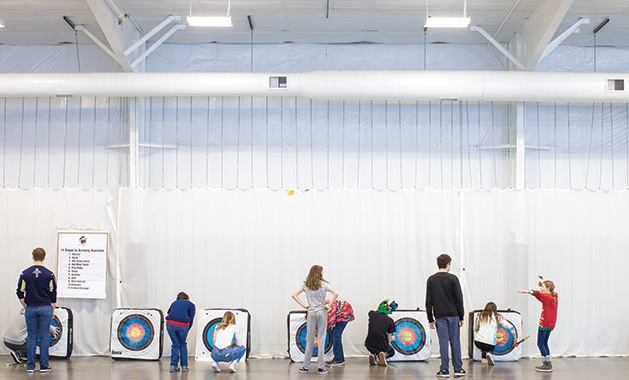 The St. Croix Preparatory Academy archery team practices in their indoor facility.