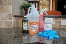 Fall cleaning products sit on a kitchen counter.