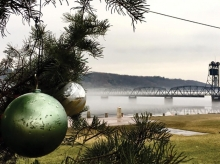 An ornamented tree sits in the foreground in front of the Stillwater Life Bridge