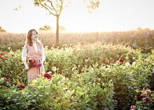 Floral designer Ashley Fox stands in a field of flowers.