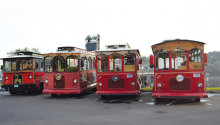 Four trolleys from Stillwater Trolley await riders before a tour of the city.