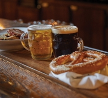 Traditional German beers and a pretzel at the Winzer Stube's Oktoberfest celebration.