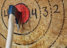An axe lodged in a target at The Lumberjack Bar