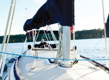 J.R. Hunter's sailboat sailing on the St. Croix River. Hunter docks the boat at Bayport Marina.