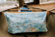 A durable fabric map from True North Map Company is affixed to a canoe during a Boundary Waters trip.