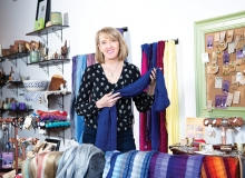Shannon Enright, owner of Small Things Fair Trade, shows off some of her wares.