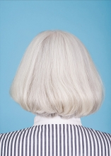 The back of a woman's head with gray hair.