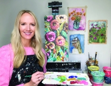 Audrey Martin poses while painting