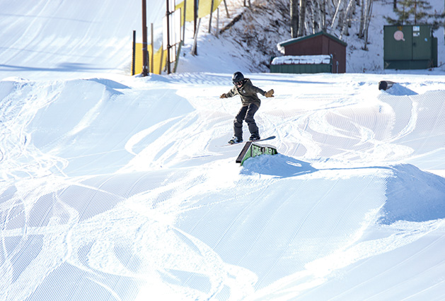 A snowboarder on the mountain at Wild Mountain