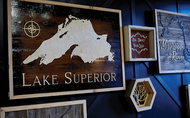 A custom wooden Lake Superior map on display at Smith + Trade Mercantile.
