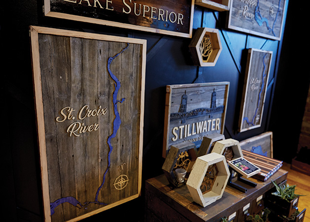 A custom wooden St. Croix River map on display at Smith + Trade Mercantile